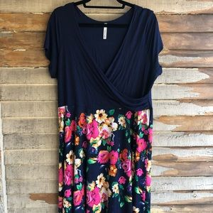 Navy blue and flowered faux wrap dress